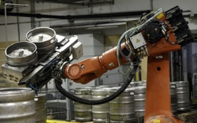 Robots are increasingly found in non-automobile-manufacturing applications. Here a mobile robot lifts empty beer barrels in the Ottakringer brewery in Vienna.