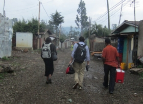 Members of the CoolComply team in Addis Ababa deliver a device to be installed in the home of a TB patient.